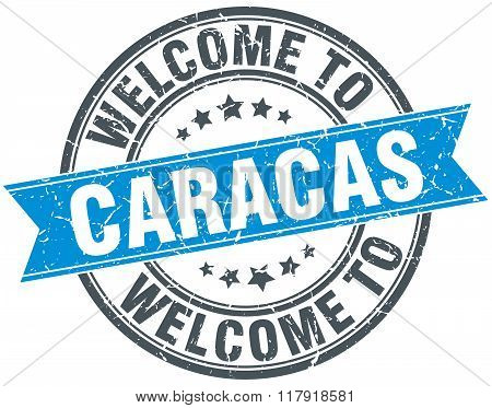 welcome to Caracas blue round vintage stamp
