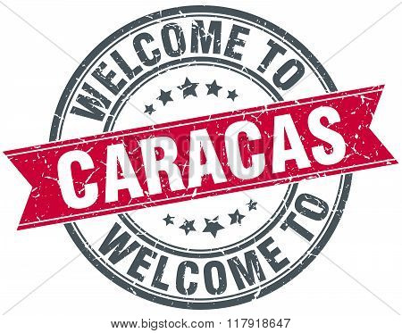 welcome to Caracas red round vintage stamp