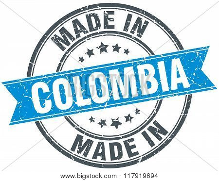 made in Colombia blue round vintage stamp