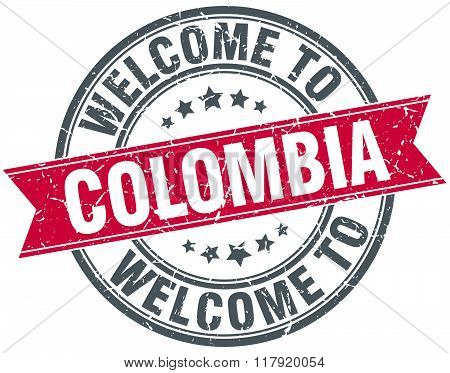welcome to Colombia red round vintage stamp
