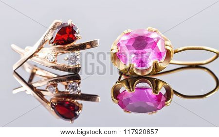 Two Gold Earrings With Rubies And Alexandrites