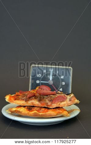 Picture of a Time for fresh prepared Pizza. Fast food concept