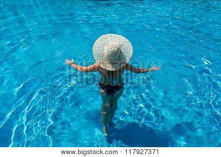 Woman relaxing at theswimming  pool