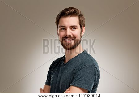 Portrait Of Attractive Smiling Young Man With Beard