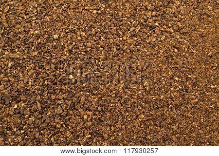 Crushed malt grains fermenting close up