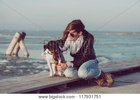 Woman and Jack russell terrier dog posing outdoor
