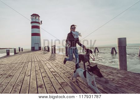 Fit woman running with dogs