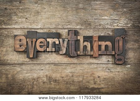 everything, word written with vintage letterpress printing blocks on rustic background