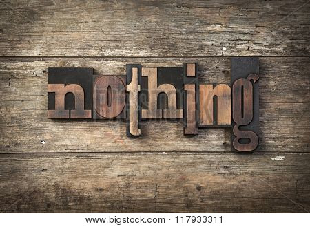 nothing, word written with vintage letterpress printing blocks on wooden background