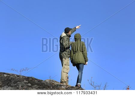 Man and woman on the top of the mountain