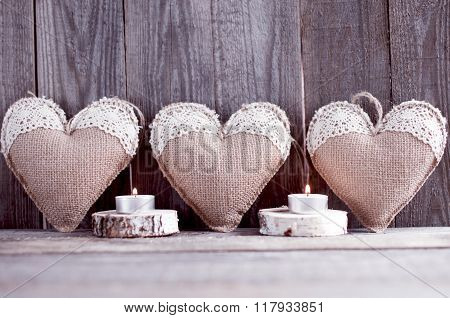 Three sackcloth handmade hearts