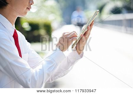 Man with tablet pc on hand