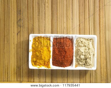 assorted spices powder in a saucer