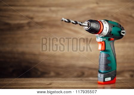 electric drill against wooden background