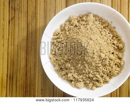 cardamon powder on the bamboo background