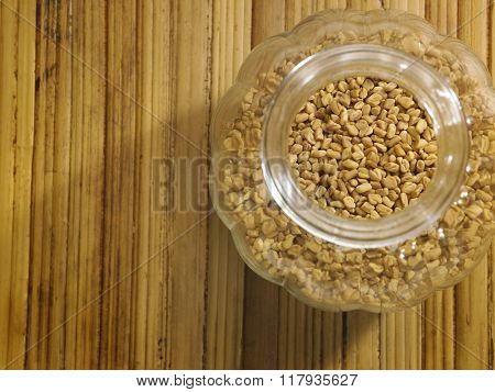 fenugreek on the bamboo background