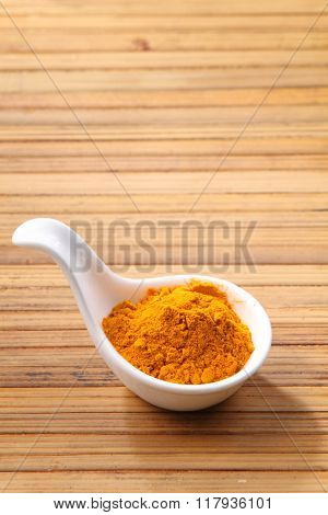 curry powder on the bamboo background