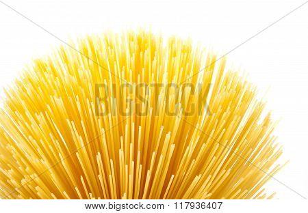 Uncooked spaghetti on white background