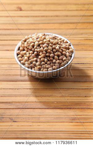 coriander  seeds on bamboo background