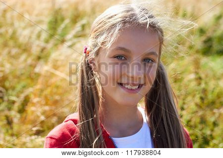 Head And Shoulders Portrait Of Girl On Walk In Countryside