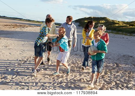 Extended Family Group Walking Along Beach