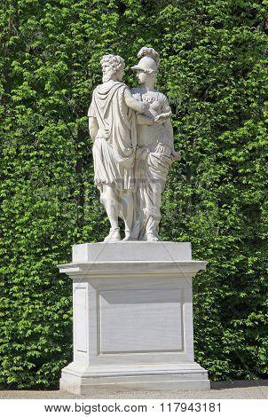 Vienna, Austria - April 26, 2013: Statue Of Janus And Bellona In Garden At Schonbrunn Palace In Vien
