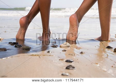 Two people on beach with crossed legs