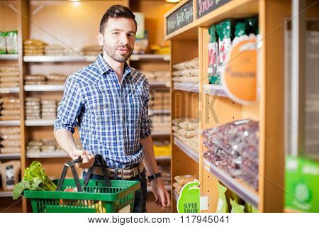 Man Buying Some Healthy Food At The Grocery Store