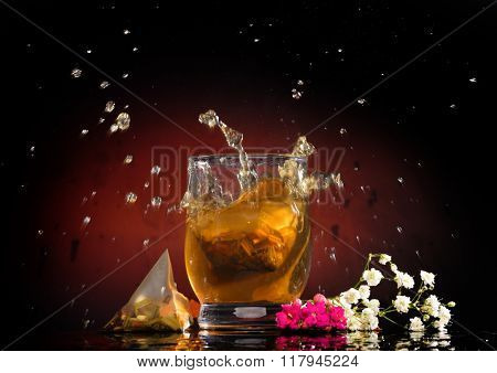 hot tea in the glass against dark background