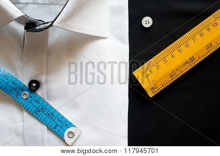 Flat lay with white shirt measuring tools