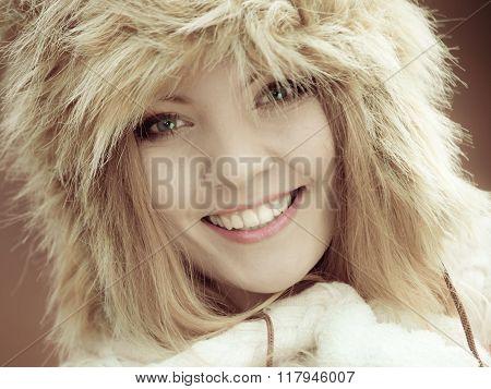 Woman In Winter Clothing Fur Cap Outdoor