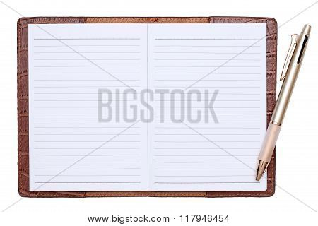 notebook with ballpoint pen