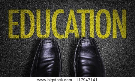 Top View of Business Shoes on the floor with the text: Education