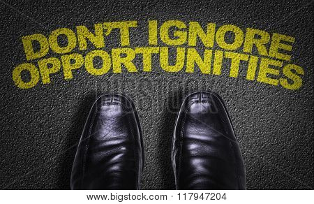 Top View of Business Shoes on the floor with the text: Don't Ignore Opportunities