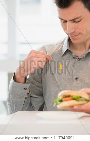 Man with mustard on his shirt