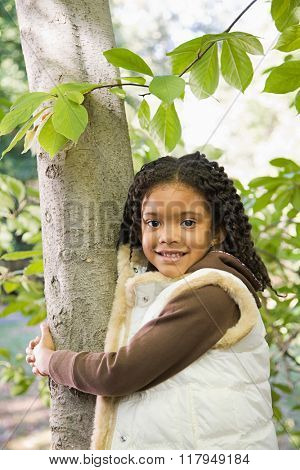 Girl holding a tree
