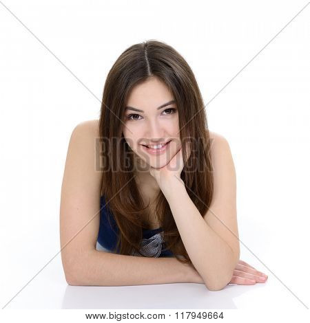 Portrait of attractive teen girl looking at camera over white
