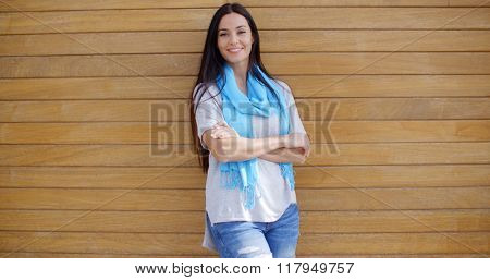 Cheerful woman with folded arms