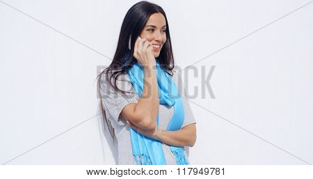 Attractive young woman talking on a mobile