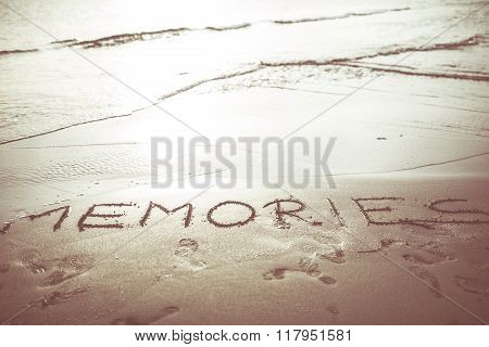 Word memories written in the sand and waves coming to erase memories.Concept of fading memories,forgetting,reflecting,remembering.Neurology and dementia or memory loss,Alzheimer disease.Vintage filter