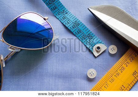 Flat lay with goggles, measuring tape, scissors, scale