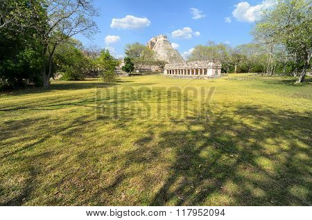 Stunning View To Mayan Ruins And Green Grass Field In Front