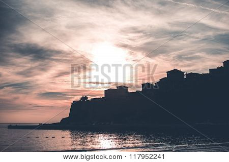 Silhouette of coastal city in beautiful sunset light,gorgeous city landscape..Old city of Ulcinj