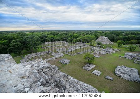 Aerial View From The Top Of Ancient Mayan Pyramid To Ruins Of City, Blue Cloudy Sky And Jungles