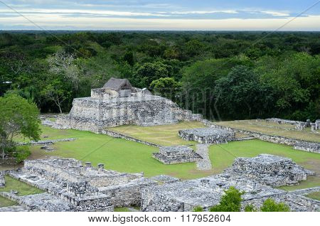 Aerial View To Mayan Ruins And House On Top Of Pyramid Surrounded By Jungle