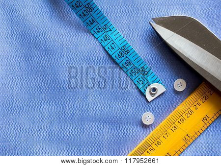 Flat lay, tailor equipment. Measuring tape, scale, buttons and s