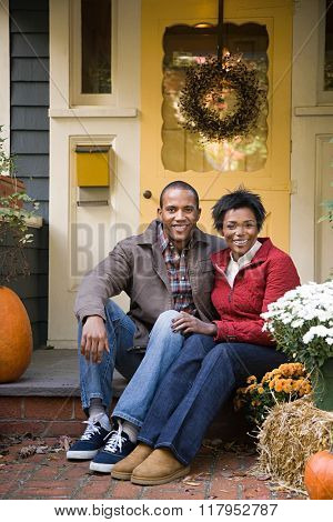 Couple outside house