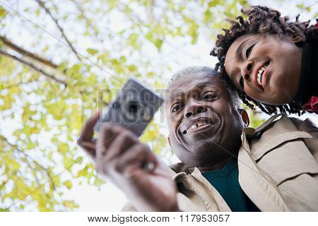 the couple using a camera