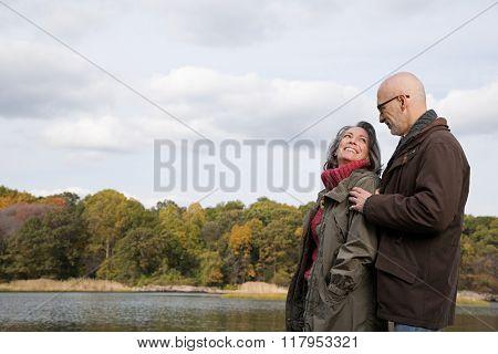 Mature couple near a lake