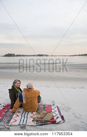 Mature couple resting at the beach